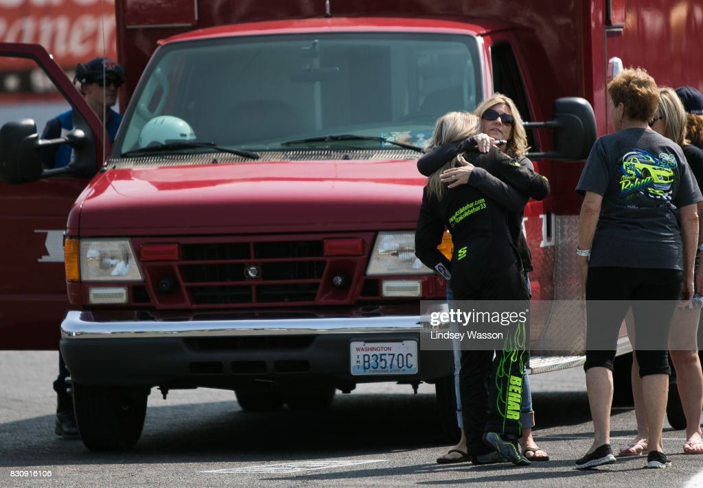 Nicole Behar #33 gets a hug after being looked at in an ambulance following a crash during final practice before the NASCAR K&N Pro Series West NAPA Auto Parts 150 on August 12, 2017 at Evergreen Speedway in Monroe, Washington. Behar finished third in the event in a backup vehicle.