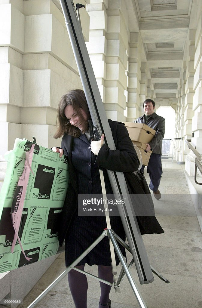 Nicole Billman and Peter Bowen, of the Balch and Bingham law firm have their hands full as they leave the House side of the Capitol on Thursday after a staff seminar.