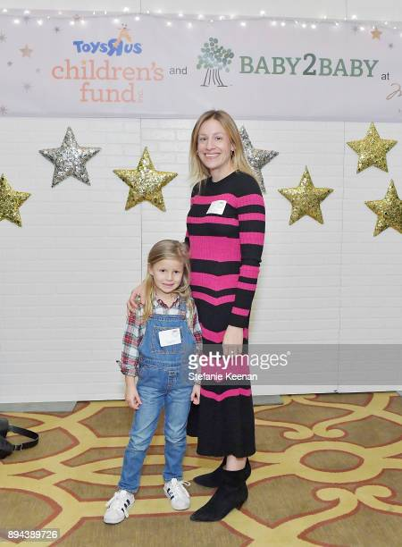Nicole Blank and child attend The Baby2Baby Holiday Party presented by Toys'R'Us at Montage Beverly Hills at Montage Beverly Hills on December 17...
