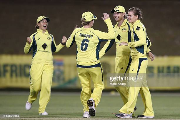 Nicole Bolton Beth Mooney Meg Lanning and Jess Jonassen of Australia celebrate a wicket during the women's One Day International match between the...