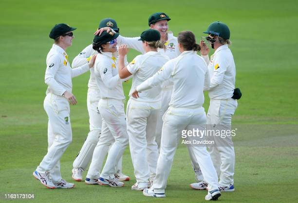 Nicole Bolton of Australia celebrates running out Georgia Elwiss of England with her teammates during Day Three of the Kia Women's Test Match between...