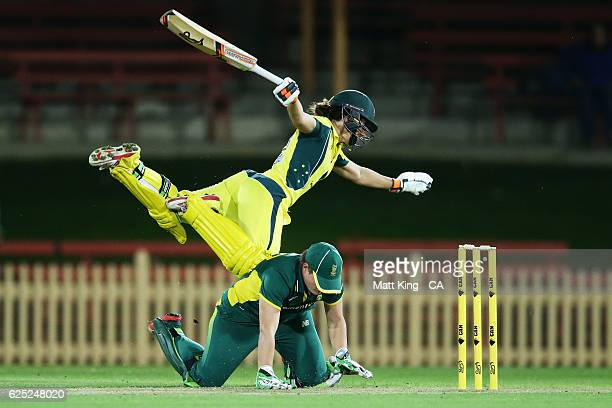 Nicole Bolton of Australia collides with South African wicketkeeper Lizelle Lee during the women's One Day International match between the Australian...