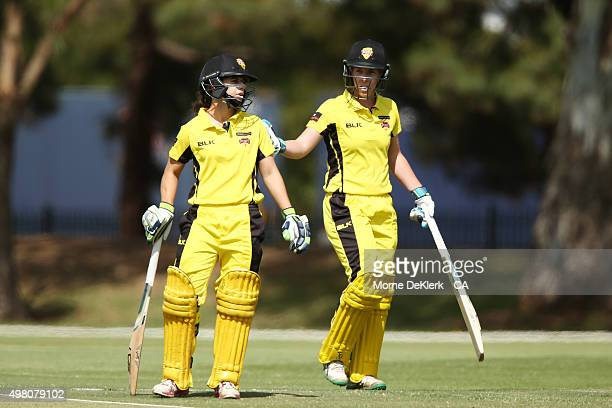Nicole Bolton of the Fury looks on as teammate Elyse Villani leaves the field after she was dismissed during the WNCL match between Tasmania and...