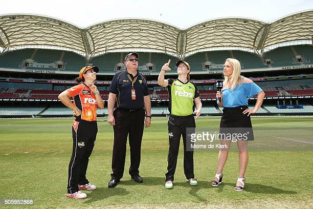 Nicole Bolton of the Perth Scorchers and Alex Blackwell of the Sydney Thunder complete the coin toss before the Women's Big Bash League match between...