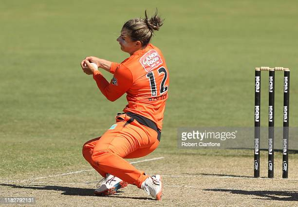 Nicole Bolton of the Perth Scorchers takes a catch off her own bowling to dismiss Tammy Beaumont of the Renegades during the Women's Big Bash League...