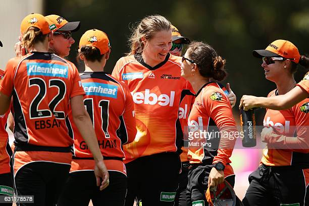 Nicole Bolton of the Scorchers celebrates with bowler Anya Shrubsole after taking a catch to dismiss Alyssa Healy of the Sixers during the Women's...
