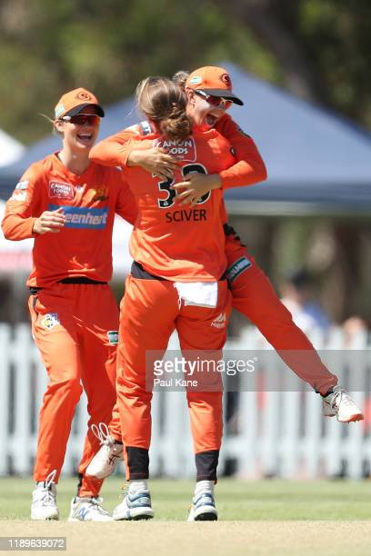 Nicole Bolton of the Scorchers celebrates with Natalie Sciver after the dismissal of Alyssa Healy of the Sixers during the Women's Big Bash League...