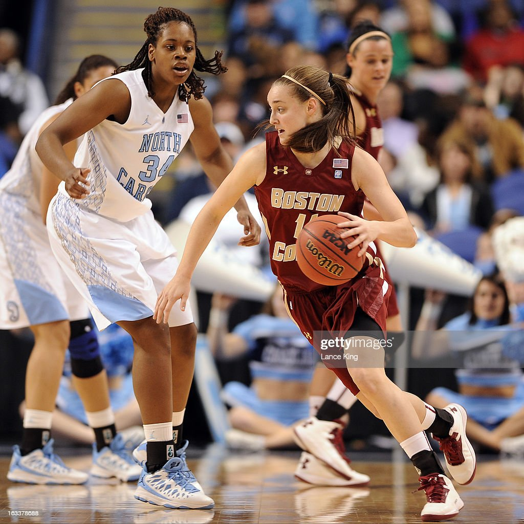 Nicole Boudreau #11 of the Boston College Eagles dribbles against Xylina McDaniel #34 of the North Carolina Tar Heels during the quarterfinals of the 2013 Women's ACC Tournament at the Greensboro Coliseum on March 8, 2013 in Greensboro, North Carolina.