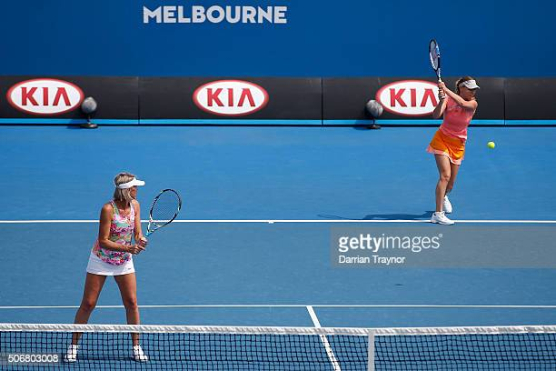 Nicole Bradkte of Australia and Barbara Schett of Austria comepete in their match against Kim Clijsters of Belgium and Iva Majoli of Croatia during...