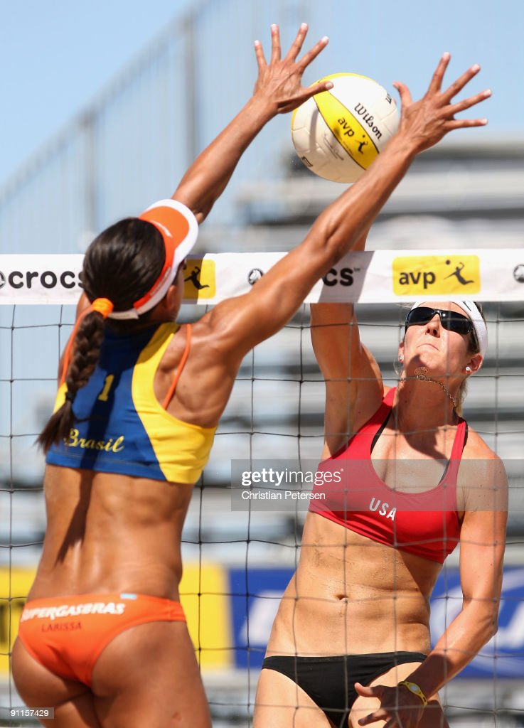 Nicole Branagh of USA hits against the block of Juliana Felisberta Silva of Brazil during the AVP Crocs Tour World Challenge at the Westgate City Center on September 25, 2009 in Glendale, Arizona.