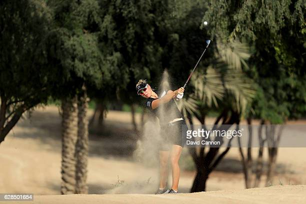 Nicole Broch Larsen of Denmark plays her second shot on the 14th hole during the completion of the first round of the 2016 Omega Dubai Ladies Masters...
