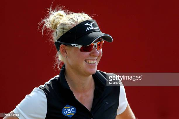 Nicole Broch Larsen of Hillerod Denmark walks off the 9th green during the first round of the Meijer LPGA Classic golf tournament at Blythefield...