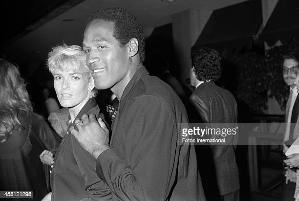 Nicole Brown Simpson and OJ Simpson attend the movie premiere of Ishtar on May 13 1987 in Century City California