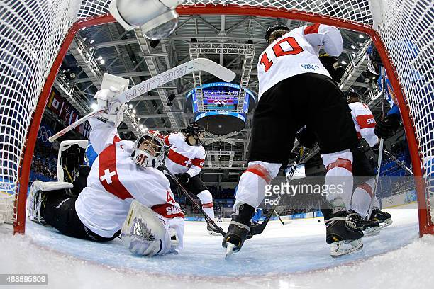 Nicole Bullo of Switzerland clears the puck out of the net against Hanna-Riika Valila of Finland during the Women's Ice Hockey Preliminary Round...