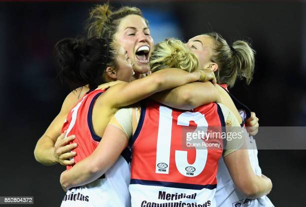 Nicole Callinan Melissa Hickey Lauren Arnell and Ebony Marinoff of Darebin celebrate winning the VFL Women's Grand Final match between Diamond Creek...