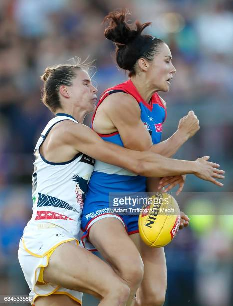 Nicole Callinan of the Bulldogs is tackled by Chelsea Randall of the Crows during the 2017 AFLW Round 02 match between the Western Bulldogs and the...