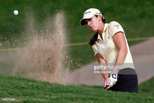 Nicole Castrale chips out of the sand on the 17th hole during the first round of the SemGroup Championship presented by John Q Hammons on Friday May...