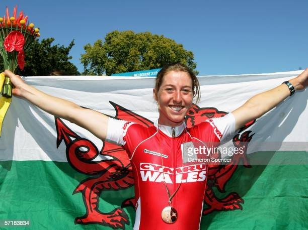 Nicole Cooke of Wales poses wearing her bronze medal after the Women's Road Race at the Royal Botanic Gardens Circuit during day eleven of the...