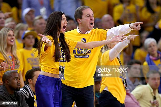 Nicole Curran and Golden State Warriors owner Joe Lacob react in the second half while taking on the Houston Rockets during game five of the Western...