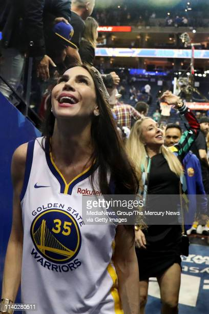 Nicole Curran, wife of Golden State Warriors majority owner Joe Lacob, interacts with fans after the Warriors 116-102 win against the Denver Nuggets...