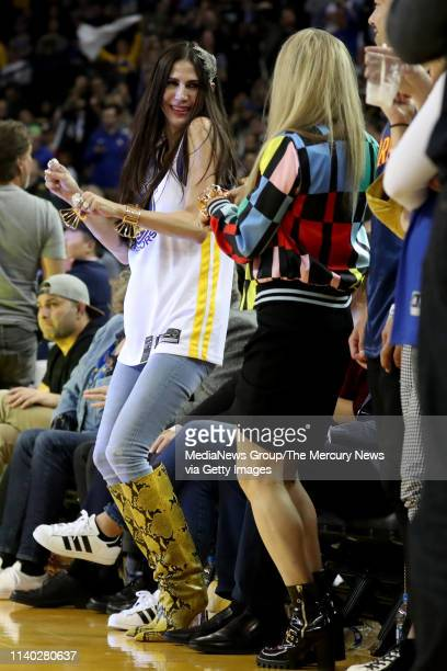 Nicole Curran, wife of Golden State Warriors majority owner Joe Lacob, makes celebratory moves on the sideline as the Warriors are en route to beat...