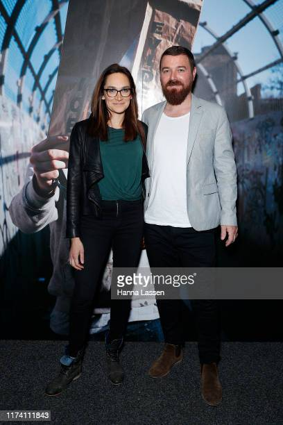 Nicole da Silva and John Chesh attend The Art of Banksy VIP preview on September 12 2019 in Sydney Australia