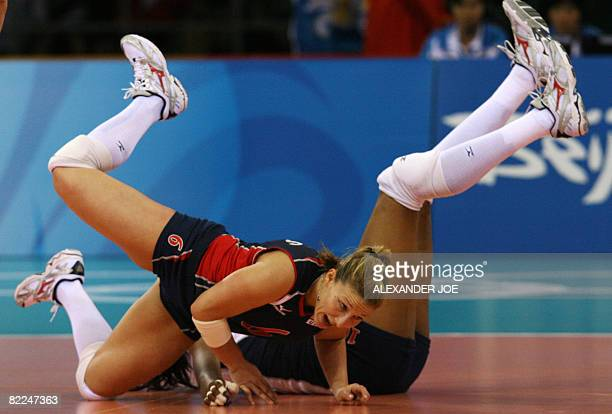 Nicole Davis and Kimberly Glass of US fall as they try to get to the ball as they play against Cuba during a 2008 Beijing Olympics Women's...