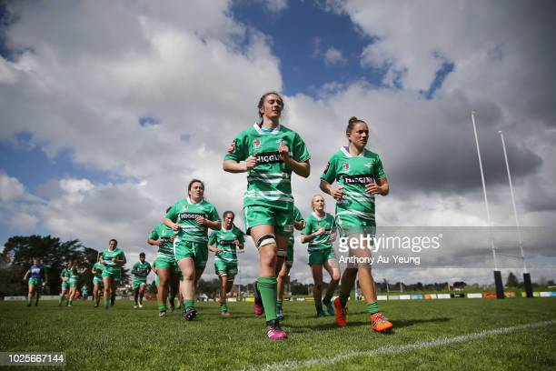 Nicole Dickins and Selica Winiata of Manawatu leads the team back to the dressing room at the half time break during the round one Farah Palmer Cup...