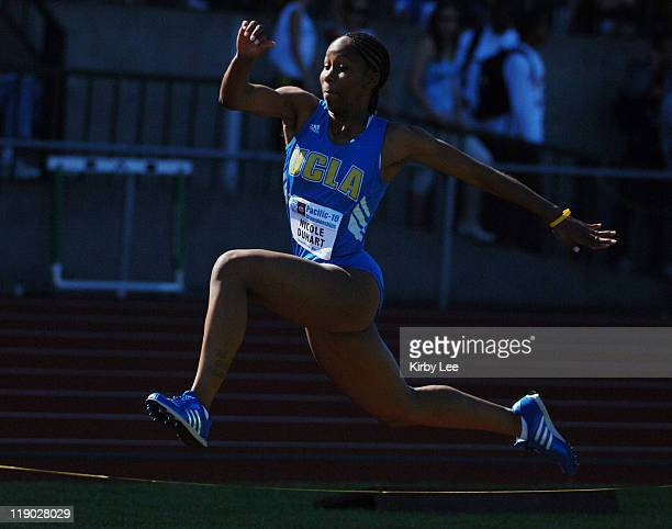 Nicole Duhart of UCLA competes in the women's triple jump in the Pacific10 Conference Track Field Championships at the University of Oregon's Hayward...