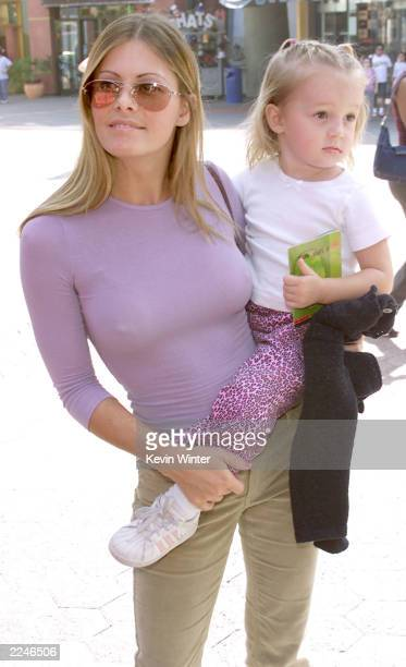 Nicole Eggert and her daughter Dilyn at the premiere screening of 'CYBERWORLD 3D' an IMAX 3D animated feature at Universal Studios IMAX Theatre at...