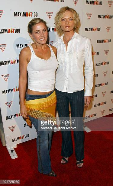 Nicole Eggert and Jaime Pressly during Maxim Hot 100 Party Arrivals at Yamashiro in Hollywood California United States