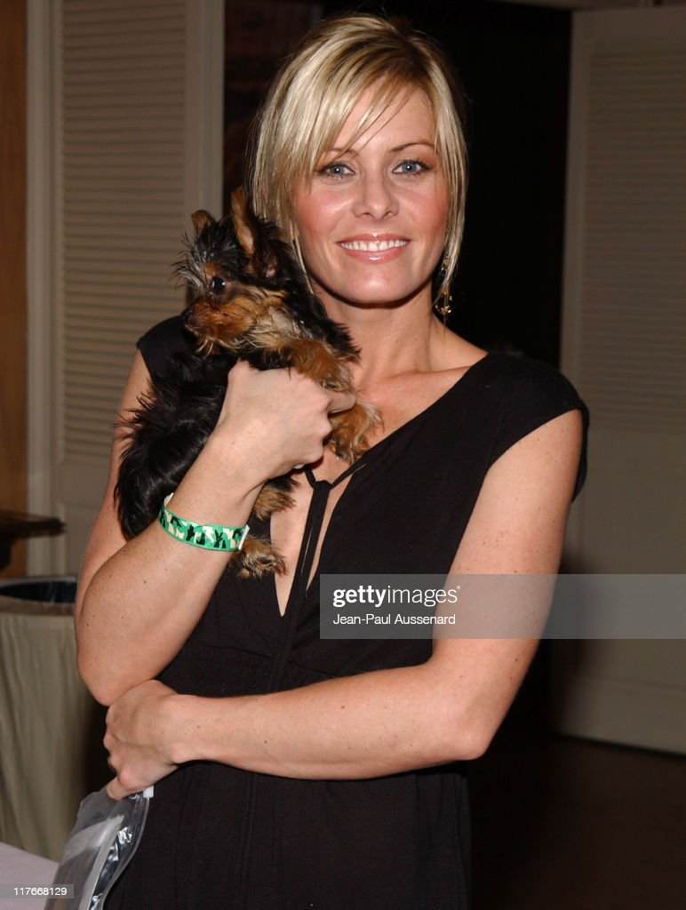 Nicole Eggert with a friend's puppy during Silver Spoon Golden Globes Hollywood Buffet - Day 1 at Private Residence in Beverly Hills, California, United States. (Photo by Jean-Paul Aussenard/WireImage for Silver Spoon (formerly The Cabana))