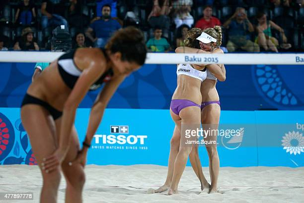 Nicole Eiholzer and Nina Betschart of Switzerland celebrate victory as Lena Maria Plesiutschnig of Austria looks dejected after the Women's Beach...