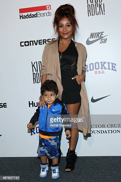 Nicole Elizabeth Snooki LaValle poses with Lorenzo backstage at the Kids Rock fashion show during Spring 2016 New York Fashion Week The Shows at The...