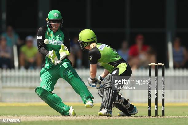 Nicole Faltum of the Stars attempts a catch off Alex Blackwell of the Thunder during the Women's Big Bash League match between the Melbourne Stars...
