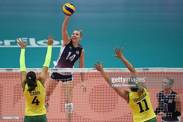 Nicole Fawcett of USA spikes as Ana Carolina Da Silva and Tandara Caixeta of Brazil block the FIVB Women's World Championship pool F match between...
