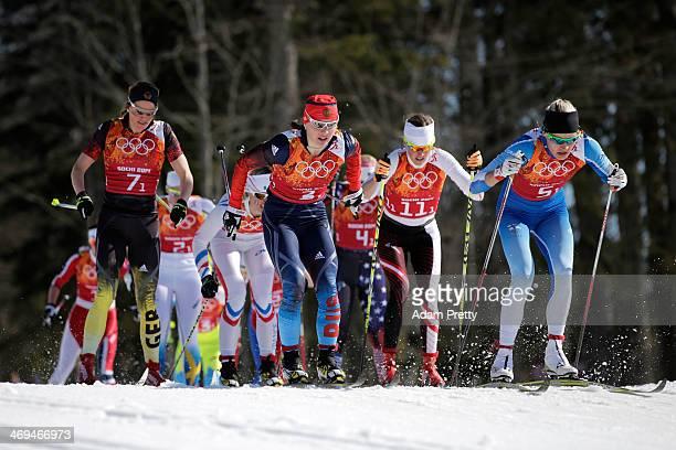 Nicole Fessel of Germany Julia Ivanova of Russia Katerina Smutna of Austria and Anne Kylloenen of Finland compete in the Women's 4 x 5 km Relay...