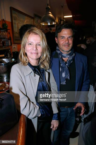 Nicole Garcia and Francois Ozon attend the Dinner in honor of Nathalie Baye at La Chope des Puces on April 30 2018 in SaintOuen France