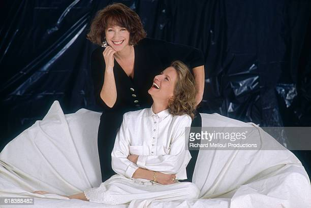 Nicole Garcia , director of the film Un week-end sur deux, laughs with actress Nathalie Baye, who stars in the film. The French film was released as...