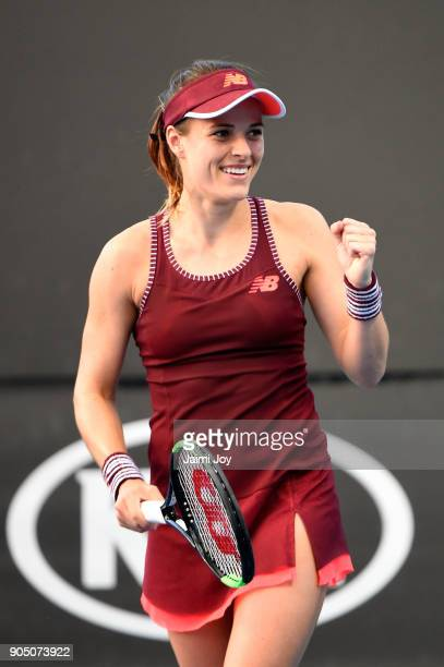 Nicole Gibbs of the United States celebrates winning a point in her first round match against Viktoriya Tomova of Bulgaria on day one of the 2018...