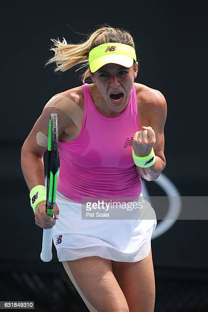 Nicole Gibbs of the United States celebrates winning the first set in her first round match against Timea Babos of Hungary on day two of the 2017...