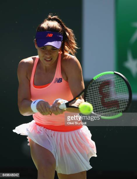 Nicole Gibbs of the United States plays a backhand against Heather Watson of Great Britain in their first round match during day three of the BNP...