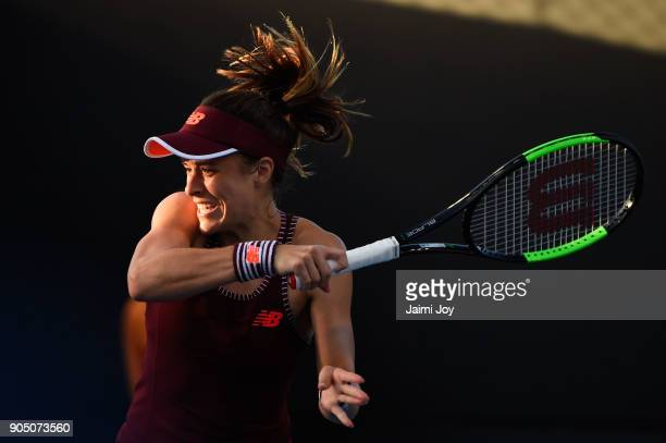 Nicole Gibbs of the United States plays a backhand in her first round match against Viktoriya Tomova of Bulgaria on day one of the 2018 Australian...