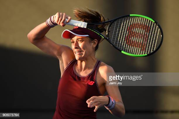 Nicole Gibbs of the United States plays a forehand in her first round match against Viktoriya Tomova of Bulgaria on day one of the 2018 Australian...