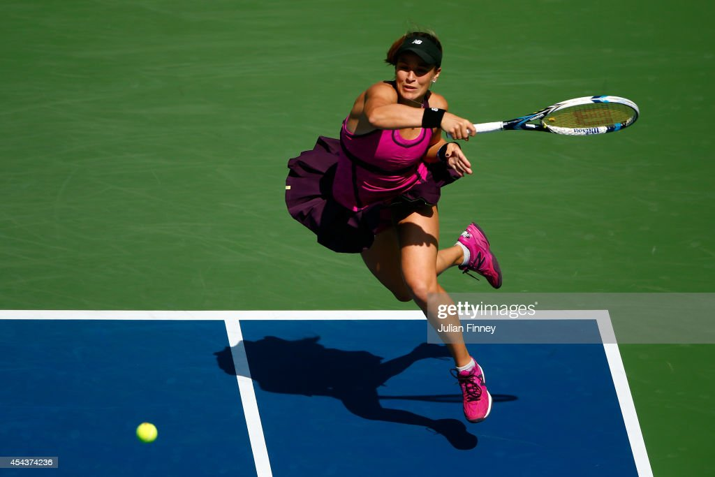 Nicole Gibbs of the United States returns a shot against Flavia Pennetta of Italy during her women's singles third round match on Day Six of the 2014 US Open at the USTA Billie Jean King National Tennis Center on August 30, 2014 in the Flushing neighborhood of the Queens borough of New York City.