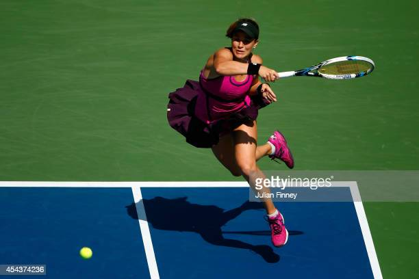 Nicole Gibbs of the United States returns a shot against Flavia Pennetta of Italy during her women's singles third round match on Day Six of the 2014...