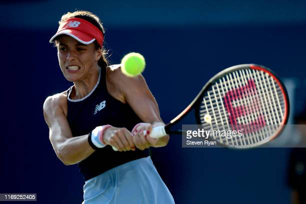 Nicole Gibbs of the United States returns a shot during her women's singles first round match against Kaylah McPhee of Australia on Day Two of the...