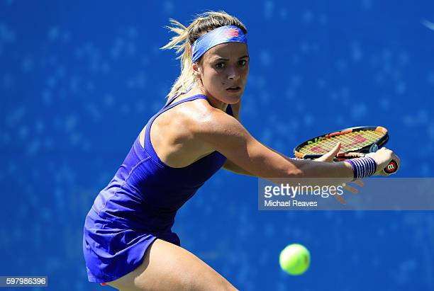 Nicole Gibbs of the United States returns a shot to Aleksandra Krunic of Serbia on Day Two of the 2016 US Open at the USTA Billie Jean King National...