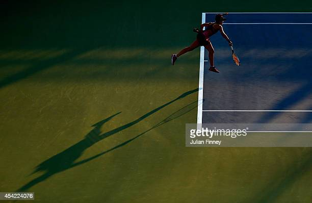 Nicole Gibbs of the United States serves against Caroline Garcia of France during their women's singles first round match on Day Two of the 2014 US...