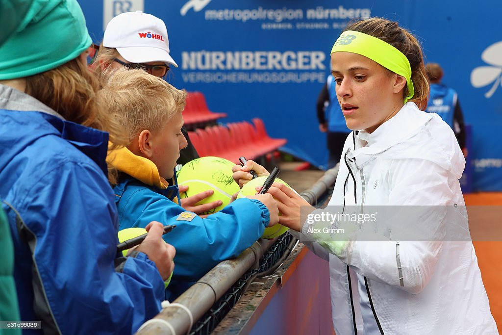 Nicole Gibbs of USA signs autographs after defeating Kristyna Pliskova oif Czech Republic during Day Two of the Nuernberger Versicherungscup 2016 on May 15, 2016 in Nuremberg, Germany.